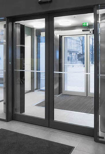 Dark KONE automatic sliding doors at Aava health service centre.